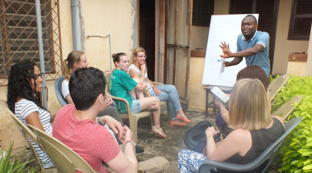 Projects Abroad volunteers participate in a language lesson as part of their gap year programme abroad
